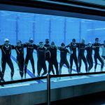 Freedivers have fun in aqua lublin behind glass