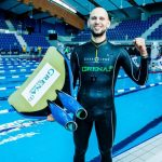 Matt Malina with monofin on surface after breaking world record in dynamic with fins