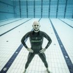 Matt Malina posing underwater freediving